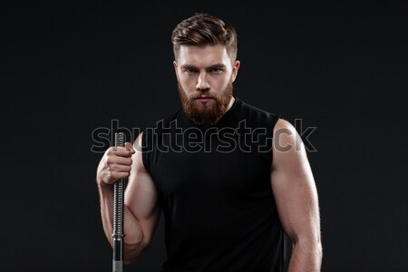 Stock photo: Young athletic man with barbell