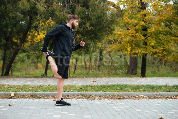 Full length runner warming up Stock photo © deandrobot