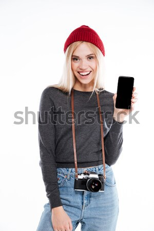 Happy girl in hat pointing finger at blank screen tablet Stock photo © deandrobot