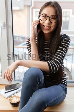 Verticaal afbeelding jonge asian vrouw praten Stockfoto © deandrobot