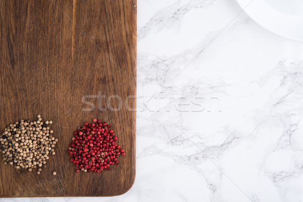 Top view of a spicy white and red peppercorn heaps Stock photo © deandrobot