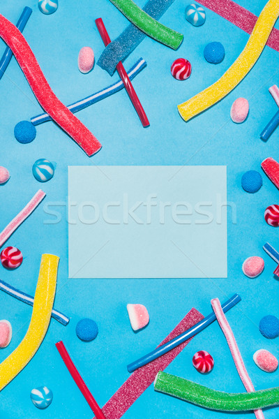 Colorful sugar candies and lollies with envelope in the middle Stock photo © deandrobot