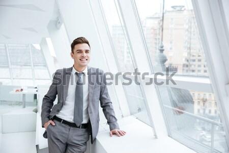 Boldog férfi fehér kabát áll kint Stock fotó © deandrobot