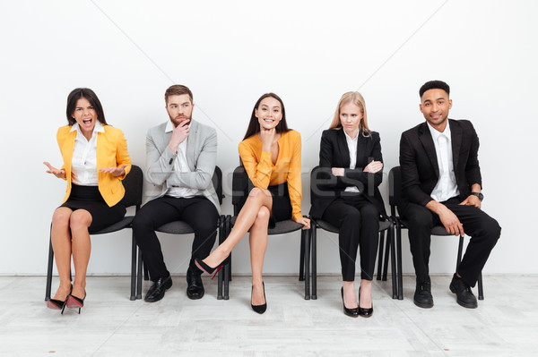 Stock photo: Colleagues sitting in office near screaming woman