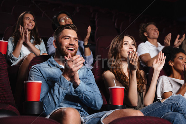 Happy smiling audience clapping hands Stock photo © deandrobot