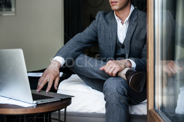 Cropped image of a businessman sitting on a bed Stock photo © deandrobot