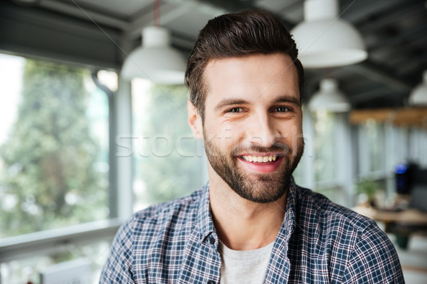 Happy man standing in office coworking Stock photo © deandrobot