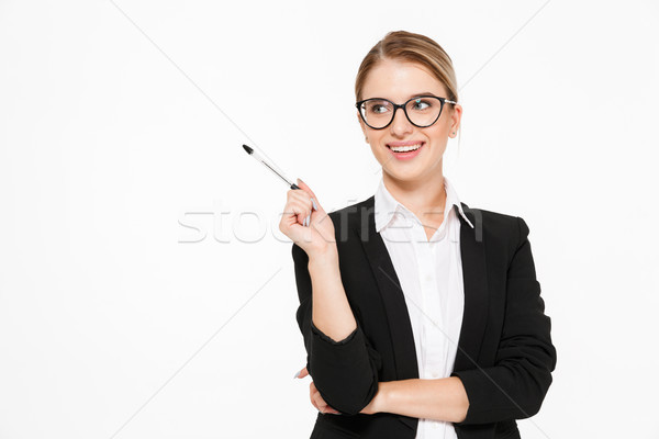 Happy blonde business woman in eyeglasses with pen in hand Stock photo © deandrobot