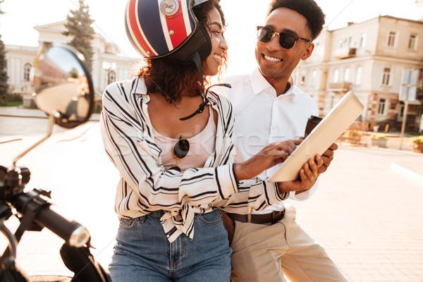 Sorridente casal sessão moderno motocicleta Foto stock © deandrobot