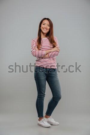 Immagine bella asian donna maglione Foto d'archivio © deandrobot