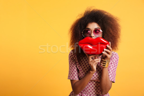 Close-up portrait of funny afro american wooman in sunglasses ho Stock photo © deandrobot