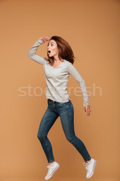 Teljes alakos fotó meglepett fiatal nő lezser visel Stock fotó © deandrobot