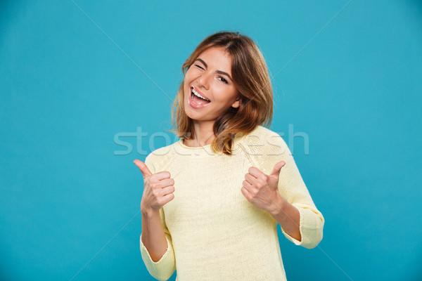 Derűs nő pulóver mutat remek kamera Stock fotó © deandrobot
