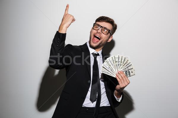 Jonge glimlachend knappe man klassiek zwart pak Stockfoto © deandrobot