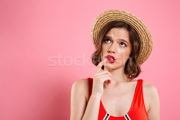 Close up portrait of a unsure doubtful girl Stock photo © deandrobot