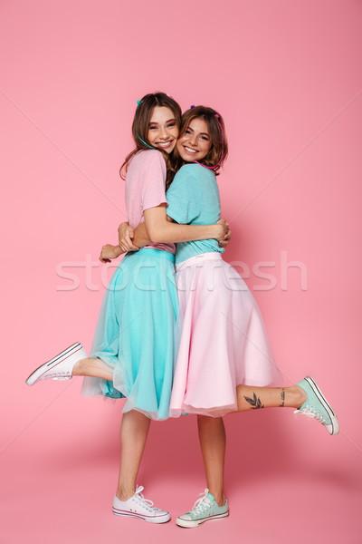 Portret dwa wesoły dziewcząt jak Zdjęcia stock © deandrobot