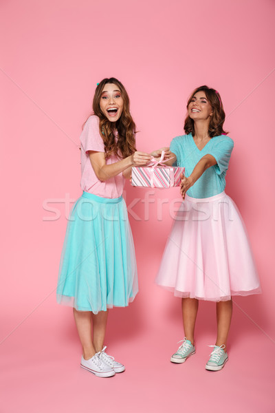 Full length photo of two overjoyed young woman dressed like chil Stock photo © deandrobot