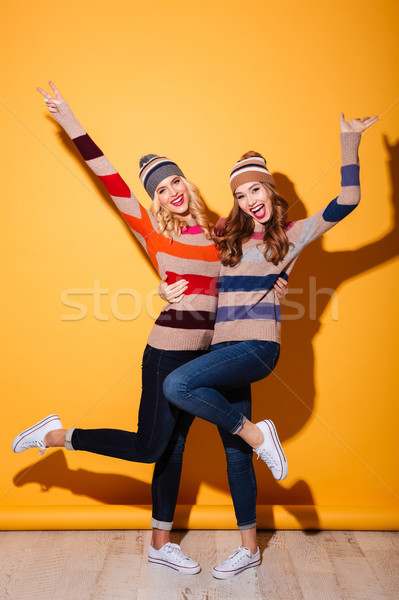 Full length portrait of two happy girls Stock photo © deandrobot