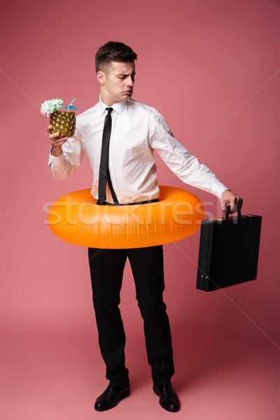 недовольный молодые бизнесмен глядя чемодан фото Сток-фото © deandrobot