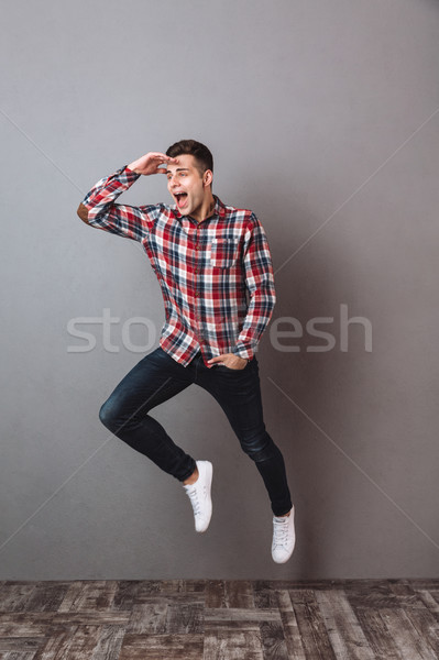 Immagine felice uomo shirt jeans Foto d'archivio © deandrobot