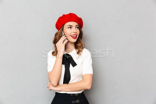 портрет школьница равномерный говорить мобильного телефона Сток-фото © deandrobot