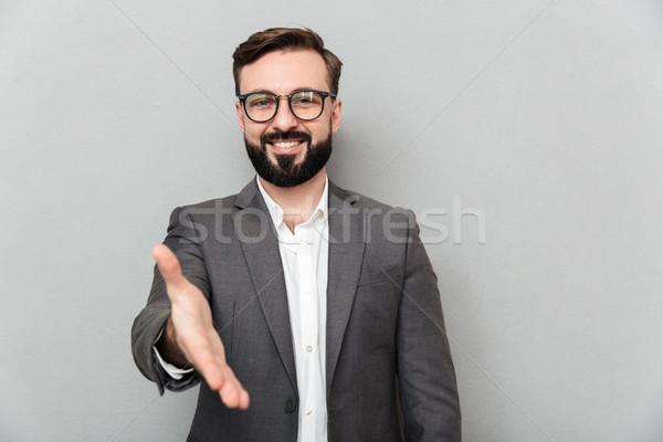 Portret przyjazny człowiek okulary patrząc Zdjęcia stock © deandrobot