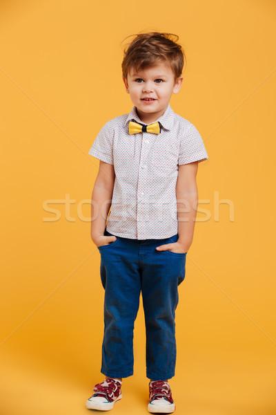 Mosolyog kicsi fiú gyermek áll izolált Stock fotó © deandrobot