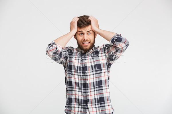Portré megrémült fiatalember néz kamera kezek Stock fotó © deandrobot