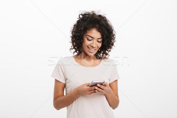 Inhalt lächelnde Frau afro eingeben Stock foto © deandrobot