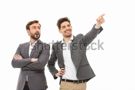 Portrait of a two excited business men looking away Stock photo © deandrobot
