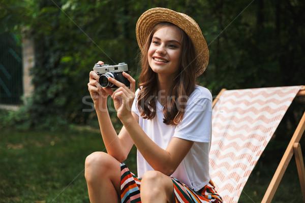 Gülen genç kız hamak şehir park Stok fotoğraf © deandrobot