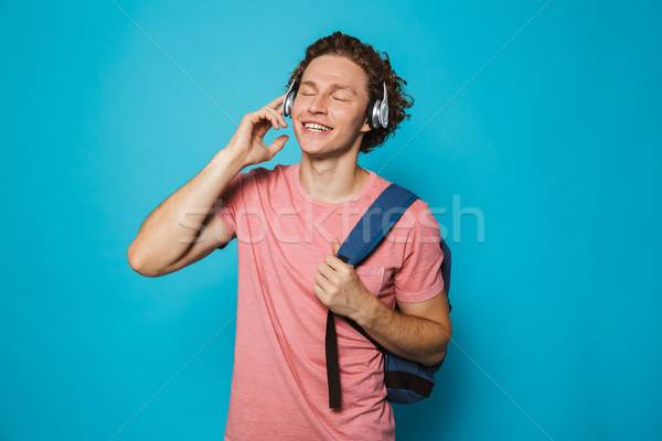 Photo of european college man 18-20 with curly hair wearing back Stock photo © deandrobot