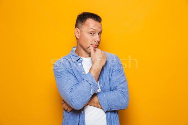 Portré figyelmes középkorú férfi néz kamera izolált Stock fotó © deandrobot