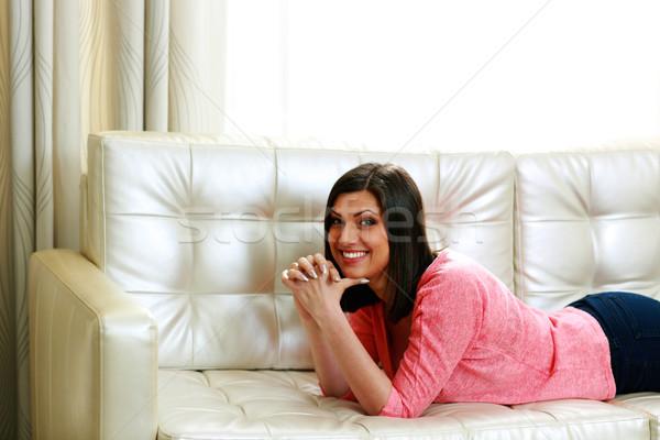 женщину диван девушки улыбка Сток-фото © deandrobot