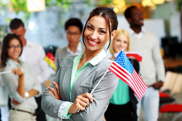 Alegre empresária bandeira EUA colegas Foto stock © deandrobot