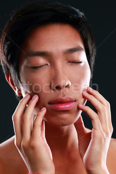 Adam gözleri kapalı eller yüz siyah genç Stok fotoğraf © deandrobot