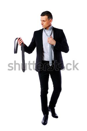 Yakışıklı işadamı kravat seçmek iş para Stok fotoğraf © deandrobot