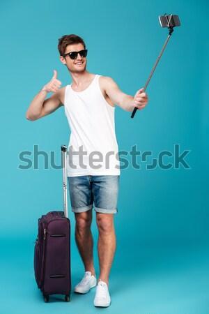 Gelukkig man zonnebril gitaar witte Stockfoto © deandrobot