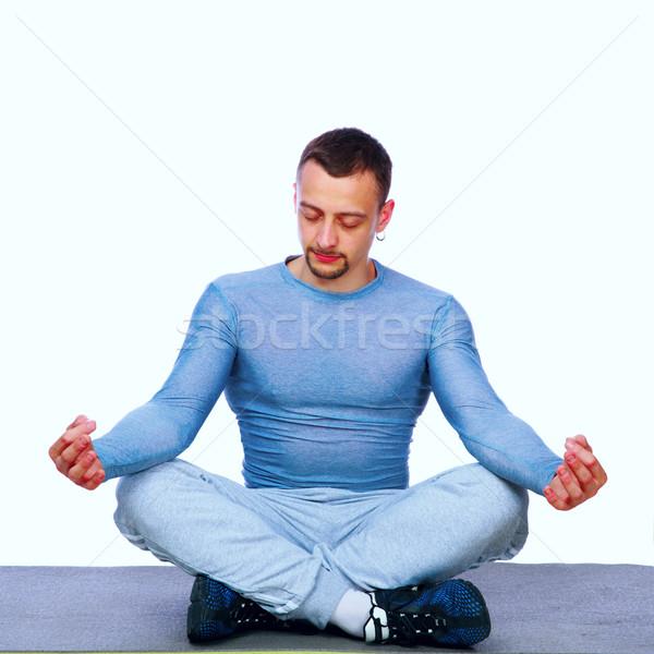 Koncentrált sportoló ül lótusz pozició szürke Stock fotó © deandrobot