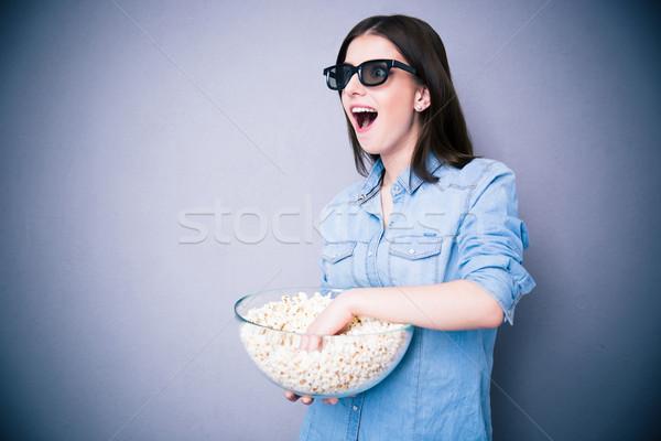 Meglepődött nő mozi szemüveg tart tál Stock fotó © deandrobot