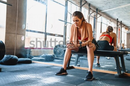 Beautiful woman tying shoelaces Stock photo © deandrobot
