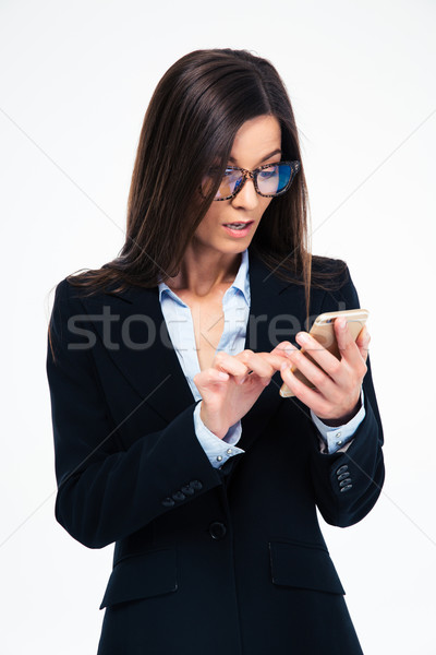Stock photo: Young businesswoman using smartphone