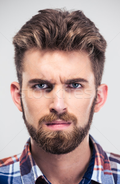 Closeup portrait of a serious man looking at camera Stock photo © deandrobot