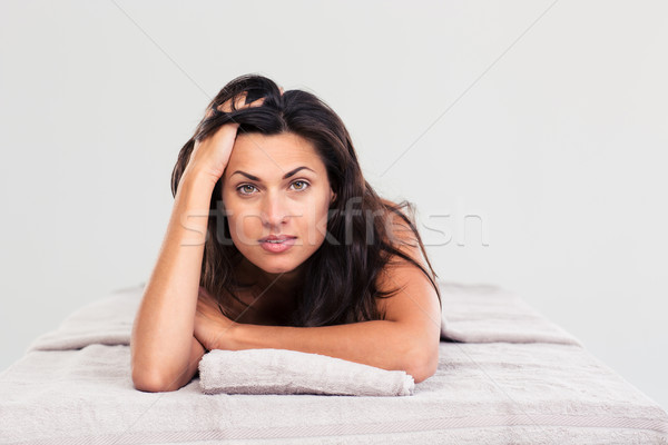 Attractive woman lying on massage lounger Stock photo © deandrobot