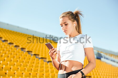 Sports woman making selfie photo on smartphon Stock photo © deandrobot