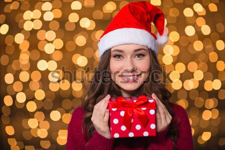 Smiling woman in grey hat and mittens holding red heart  Stock photo © deandrobot