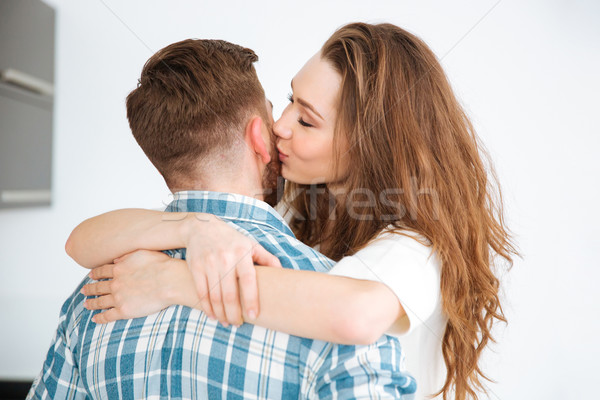 Woman hugging and kissing her boyfriend Stock photo © deandrobot
