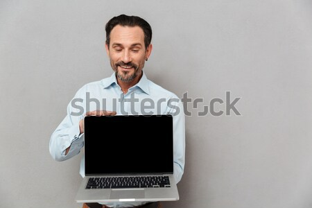 Stock photo: Man showing blank laptop computer screen