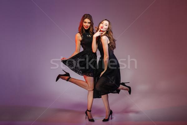 Dwie kobiety noc czarna sukienka portret Zdjęcia stock © deandrobot
