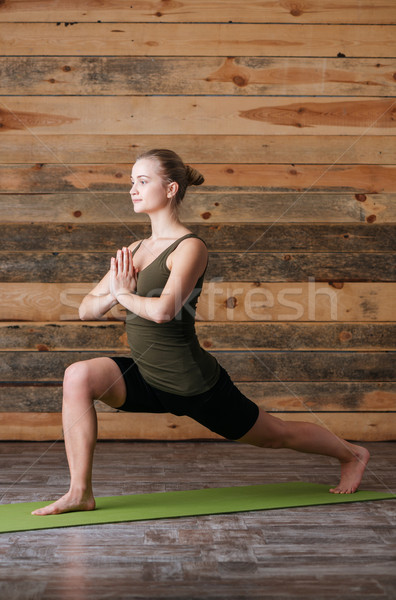 Woman workout on yoga mat Stock photo © deandrobot